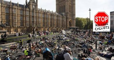 "Cyclists protest in mass ""die-in"" outside Parliament"